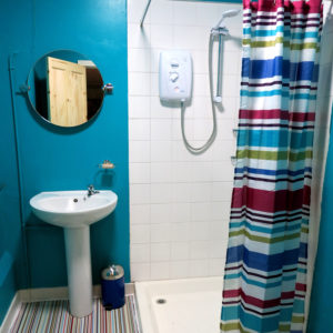 Female bathroom showing shower and sink